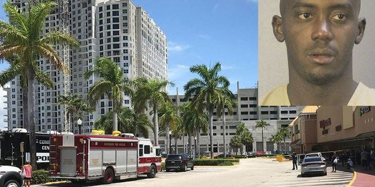 Naked man throws objects from high-rise building