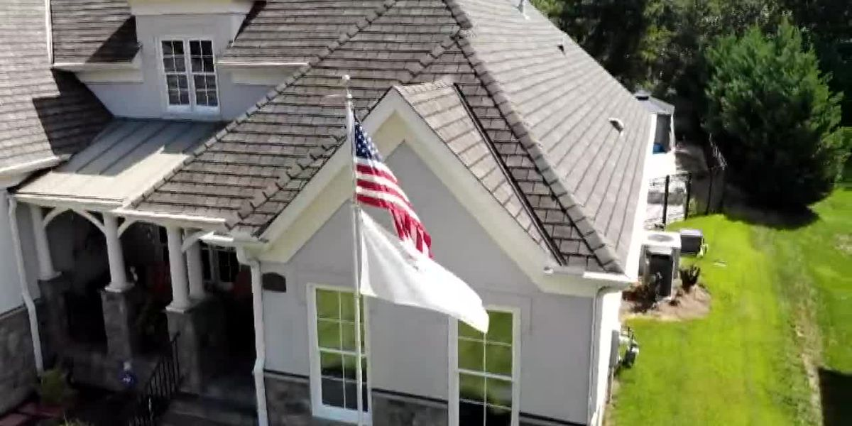 Family fights to keep flagpole in yard to honor late son