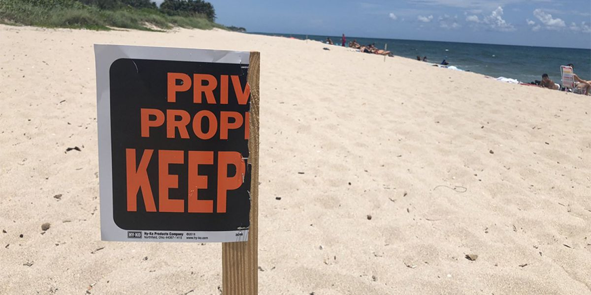 Private property signs mark off beach north of Boynton Beach Inlet