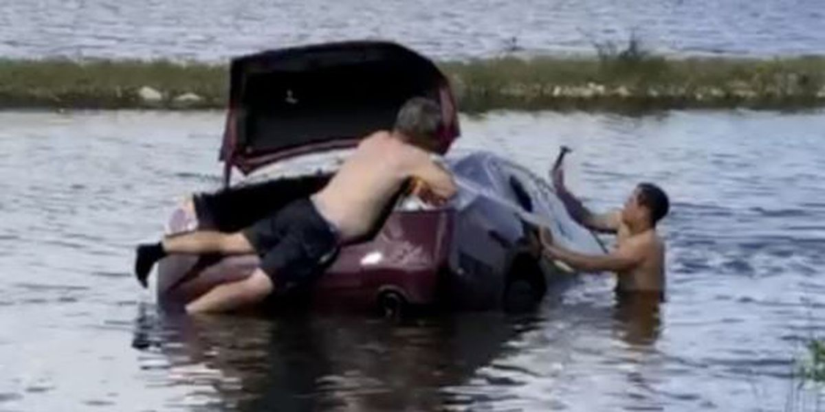 VIDEO: Heroes rescue woman who crashed into canal