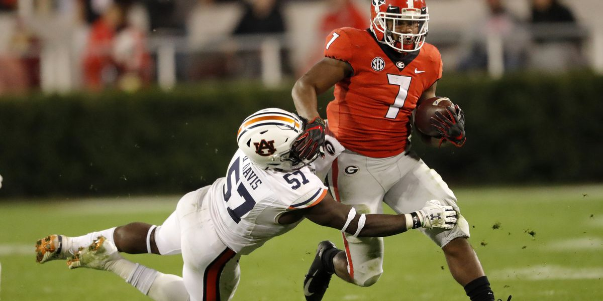 Swift runs for 186 yards, No. 5 Georgia beats Auburn 27-10