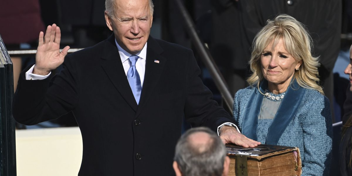 Biden takes the helm, appeals for unity to take on crises