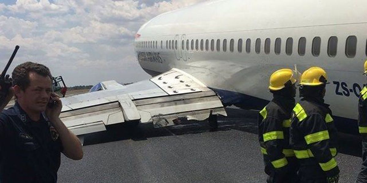 British Airways Comair flight skids on runway as landing gear collapses
