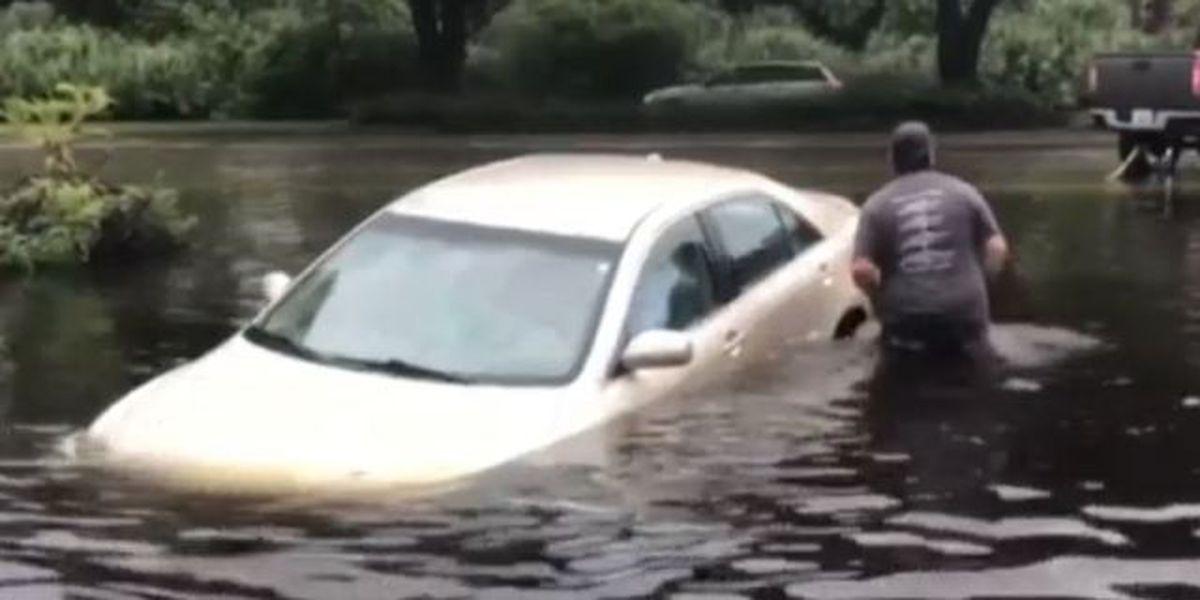 Cars damaged after severe flooding in Hobe Sound