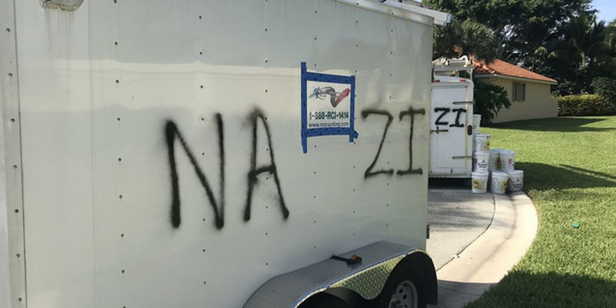 Hateful words spray painted on trailers