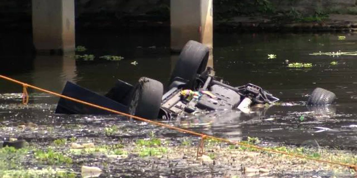 Person hospitalized after car plunges into pond