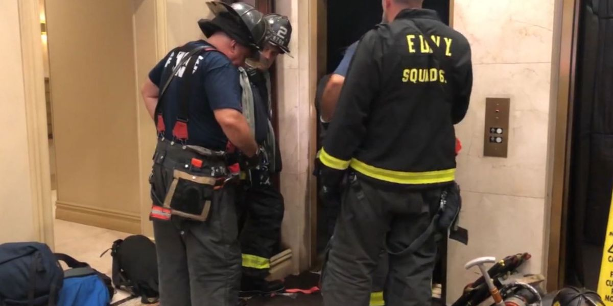 Elevator passenger dies, trapped between car and shaft