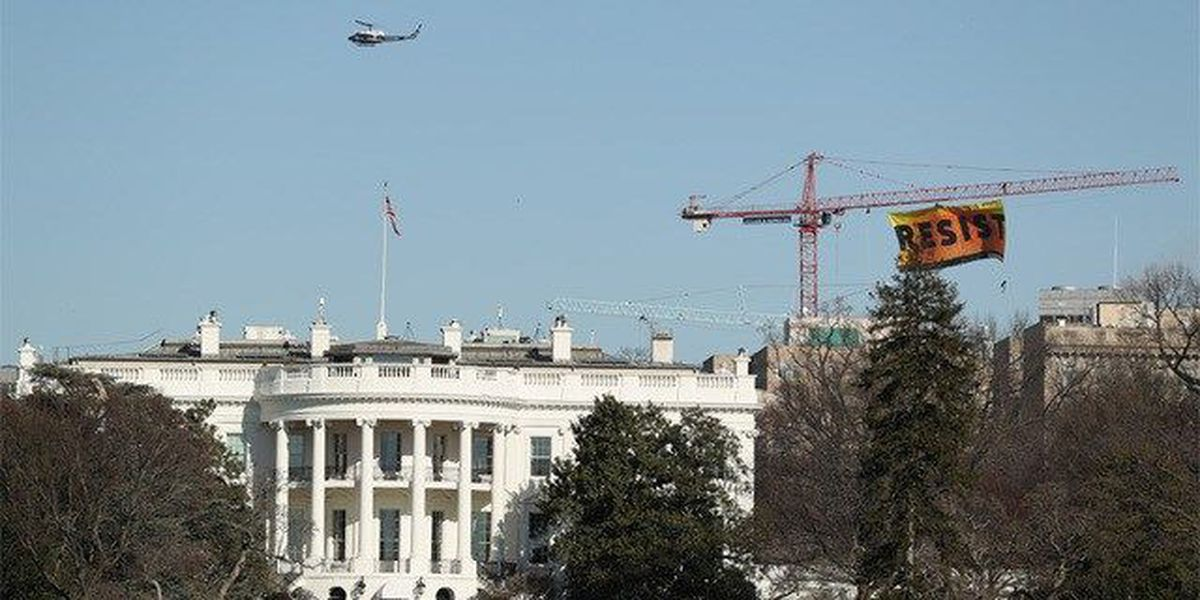 Protesters climb DC crane, call for resistance
