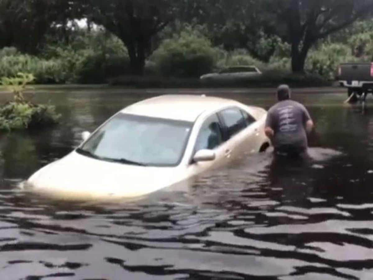 Cars damaged after severe flooding in Hobe Sound