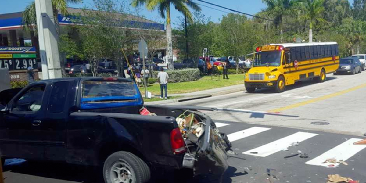 Truck and school bus collide in suburban West Palm Beach