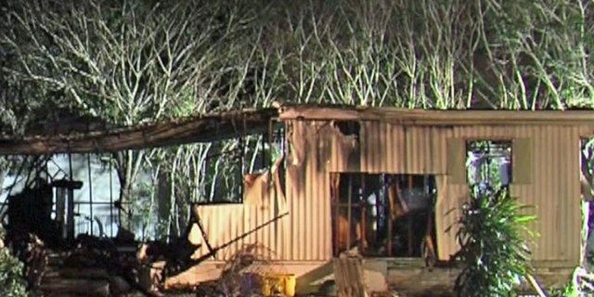 Fire destroys mobile home, two hurt