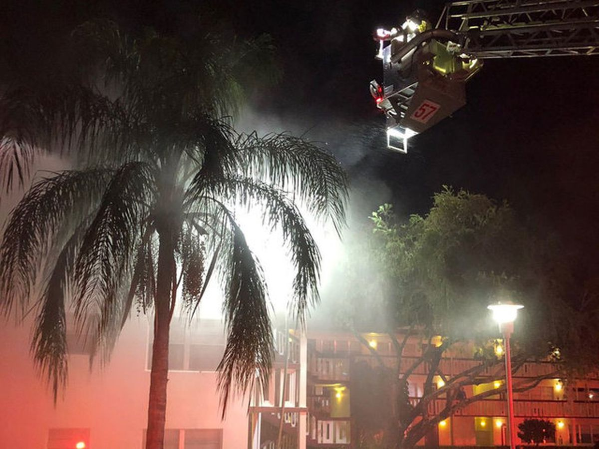 Firefighters battle third-story apartment fire