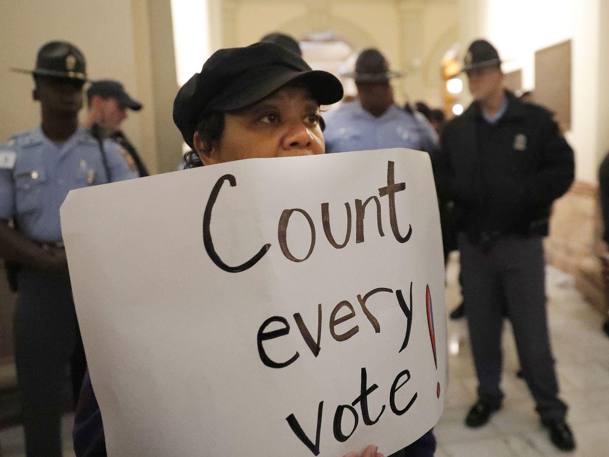 Heated Georgia gov's race: Absentee ballots in the spotlight