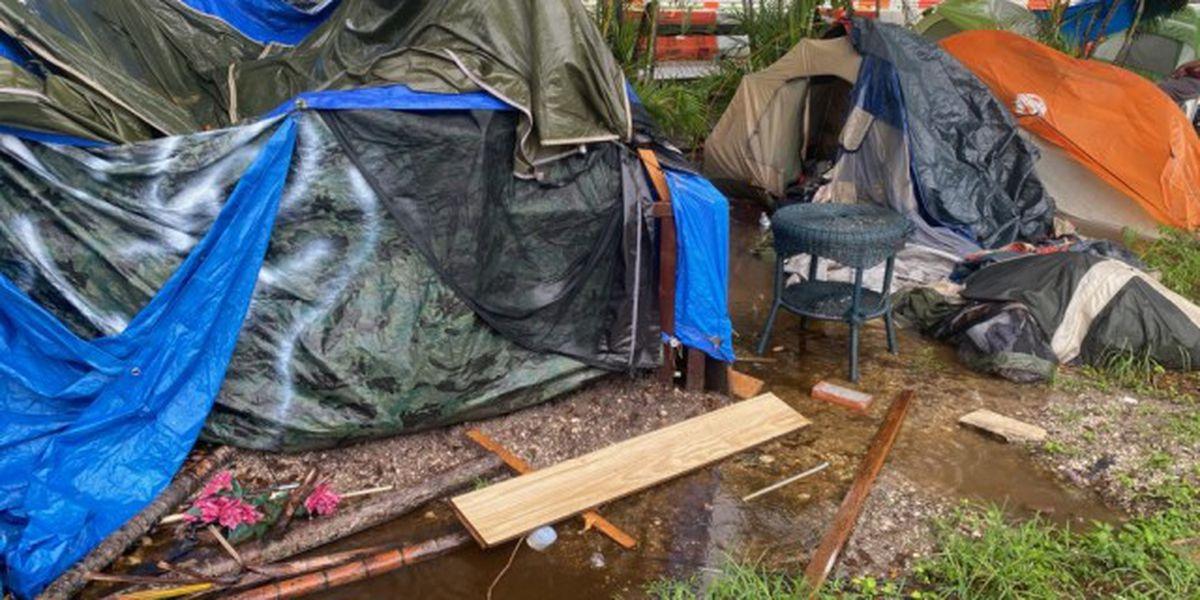 Park inhabitants wait for emergency shelter amid storms, flooding
