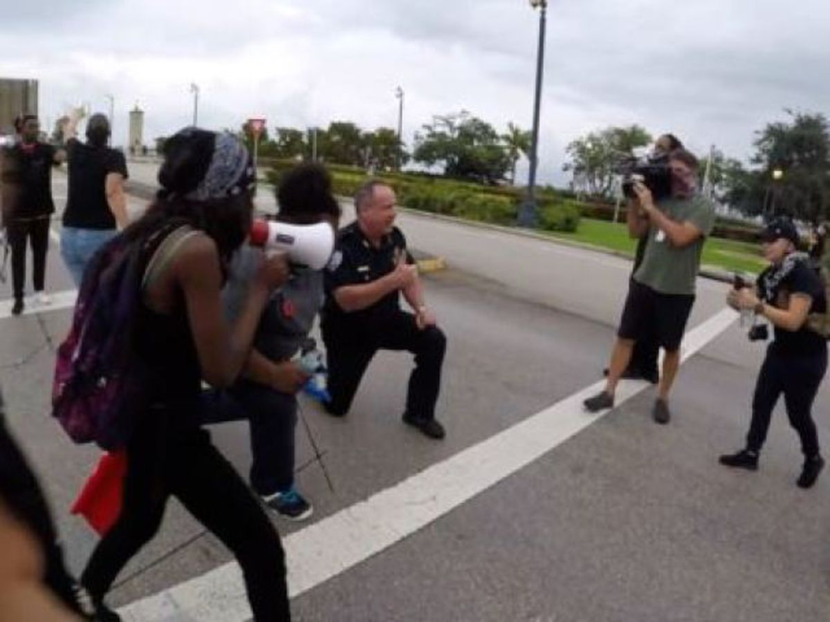 West Palm Beach police deputy chief kneels with protesters