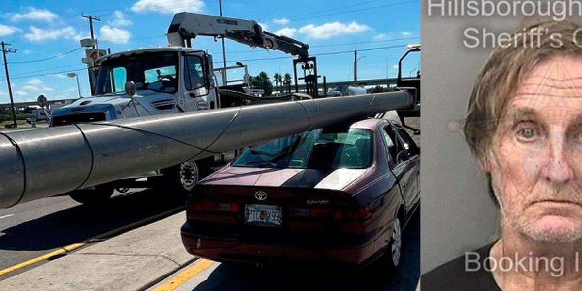 Florida man caught with stolen light pole on his car hood
