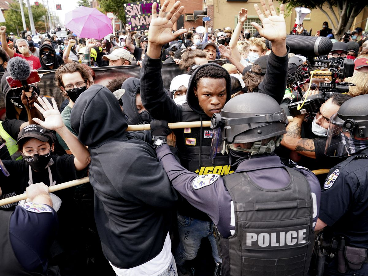 In despair, protesters take to streets for Breonna Taylor