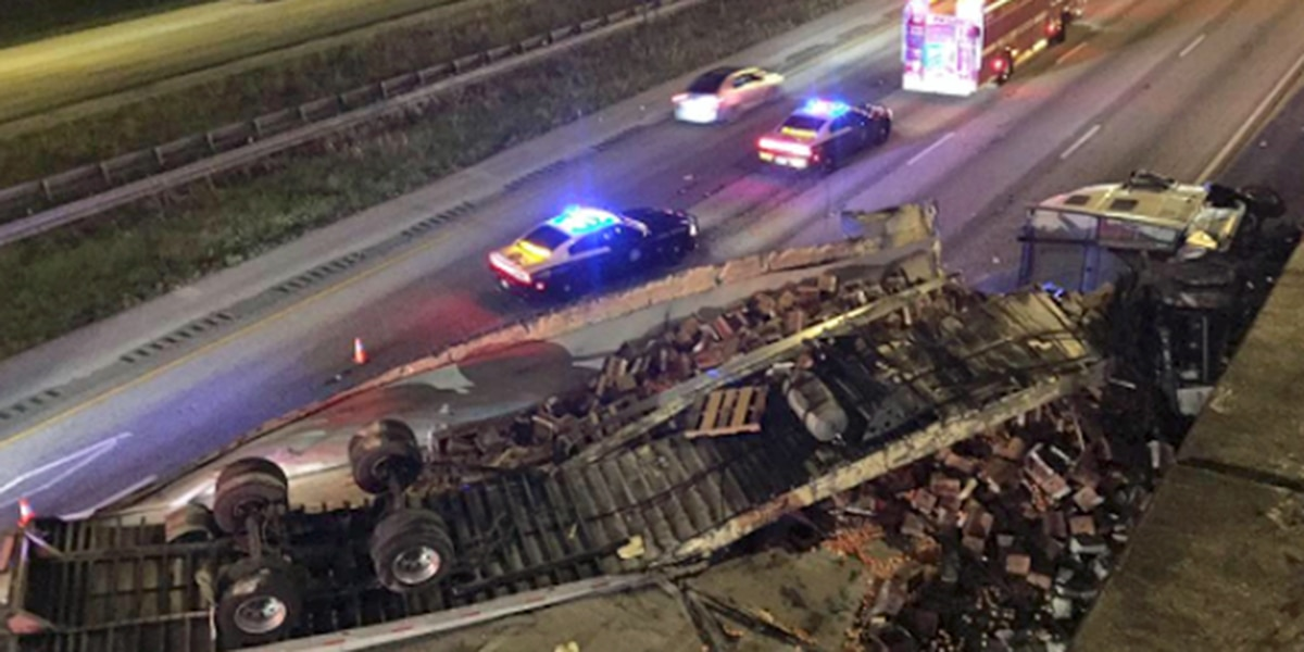 Semi truck drives through overpass, lands on Congress Avenue and I-95 in Boca Raton