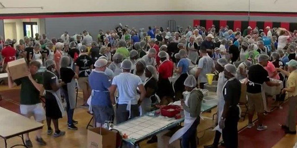 Multi-faith volunteers pack meals in West Palm