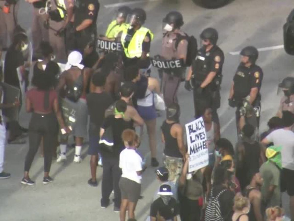 Protesters march along I-95 in West Palm Beach