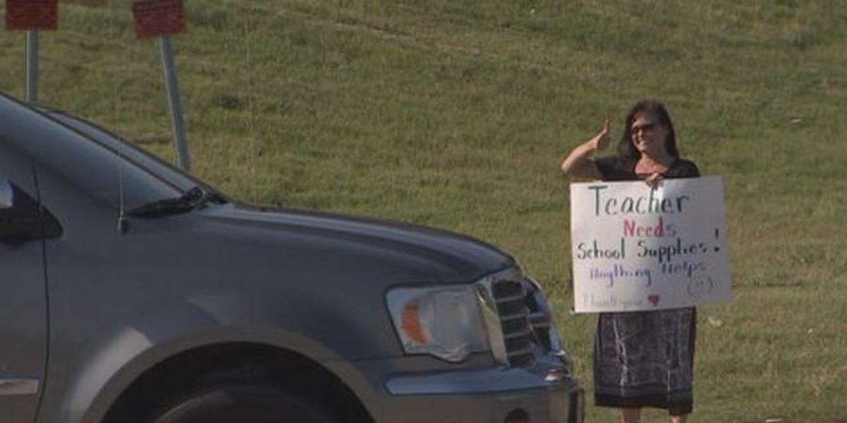 Teacher turns to panhandling to raise money