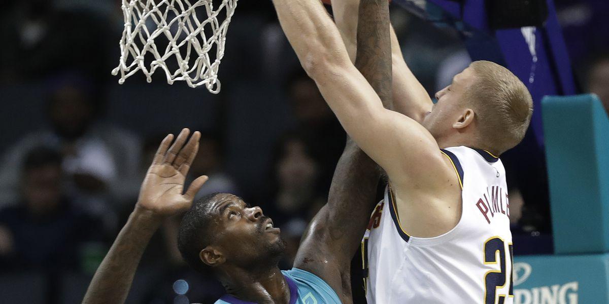 Walker scores 21, Hornets snap Nuggets' 7-game win streak